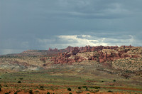 Thunder clouds over rock formations at Arches Nat Park UT 9-3-05